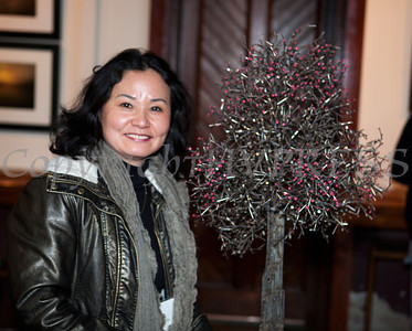 """The Howland Cultural Center in Beacon celebrated Women's History Month with an art exhibit that featured work by many artists including Insun Kim, which opened on Saturday, March 1, 2014. Kim poses with her stainless steel sculpture of nails titled """"Cherry Blossom. Hudson Valley Press/CHUCK STEWART, JR."""