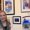 The Howland Cultural Center in Beacon celebrated Women's History Month with an art exhibit that featured work by many artists including Kate Vikstrom, which opened on Saturday, March 1, 2014. Vikstrom poses with her water color paintings. Hudson Valley Press/CHUCK STEWART, JR.