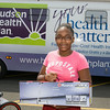 12-year-old Azizah received a Razor Scooter during Hudson Health Plan's free Bicycle Safety Rodeo on Saturday, August 16, 2014, at Second Baptist Church in Middletown, NY. Hudson Valley Press/CHUCK STEWART, JR.