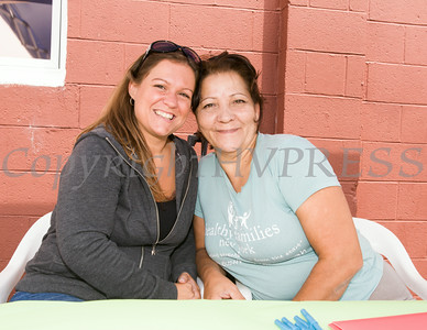 Amanda Myers and Maria Roberts of Healthy Families NY provided free information to the public during Hudson Health Plan's free Bicycle Safety Rodeo on Saturday, August 16, 2014, at Second Baptist Church in Middletown, NY. Hudson Valley Press/CHUCK STEWART, JR.