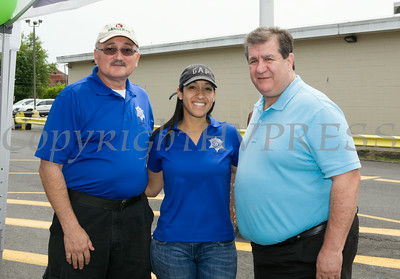 Robert Rushing and Barbara Martinez of the Orange County Sheriff's Office with Middletown Mayor Joseph DeStefano during Hudson Health Plan's free Bicycle Safety Rodeo on Saturday, August 16, 2014, at Second Baptist Church in Middletown, NY. Hudson Valley Press/CHUCK STEWART, JR.