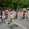 Children line up for the bike safety course during Hudson Health Plan's free Bicycle Safety Rodeo on Saturday, August 16, 2014, at Second Baptist Church in Middletown, NY. Hudson Valley Press/CHUCK STEWART, JR.