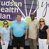 Juana Leandry-Torres, Middletown Mayor Joseph  DeStefano, Rev. Leroy Noel, and Rosina Tezgeldi at Hudson Health Plan's free Bicycle Safety Rodeo on Saturday, August 16, 2014, at Second Baptist Church in Middletown, NY. Hudson Valley Press/CHUCK STEWART, JR.