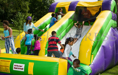 Children enjoy an inflatable ride in Downing Park as part of the I'm So Newburgh Stop the Violence event on Saturday, August 23, 2014. Hudson Valley Press/CHUCK STEWART, JR.