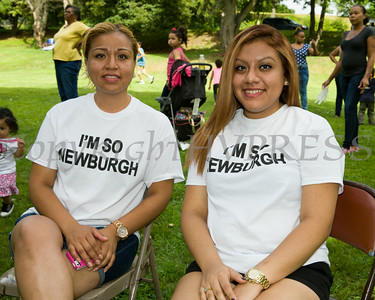 Veronica Jimenez and daughter Jailene Uraje enjoy the entertainment in Downing Park as part of the I'm So Newburgh Stop the Violence event on Saturday, August 23, 2014. Hudson Valley Press/CHUCK STEWART, JR.