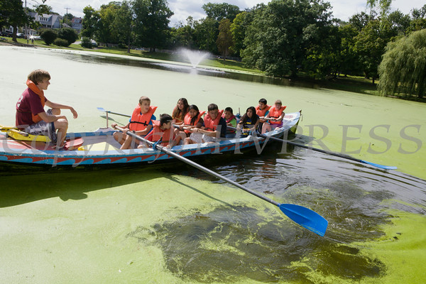 Members of the Newburgh Rowing Club take children for a ride around the polly in Downing Park as part of the I'm So Newburgh Stop the Violence event on Saturday, August 23, 2014. Hudson Valley Press/CHUCK STEWART, JR.