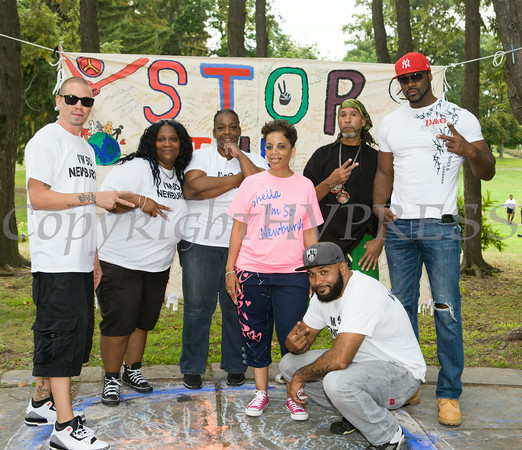 "DJ G Rock, Rasheda Worth, Jan Murchison, Sheila Murphy, Joe ""Flo"" Alvarez (in front), Omari Shakur and James (Angel Sstar) Thorpe planned and organized the I'm So Newburgh Stop the Violence event on Saturday, August 23, 2014 in Downing Park. Hudson Valley Press/CHUCK STEWART, JR."