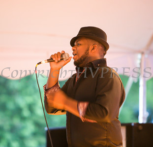 "Michael Cole of The Voices of Glory belts out the Sam Cook tune ""A Change is Gonna Come"" at the 26th Annual International Festival held over the Labor Day Weekend in the City of Newburgh. Hudson Valley Press/CHUCK STEWART, JR."