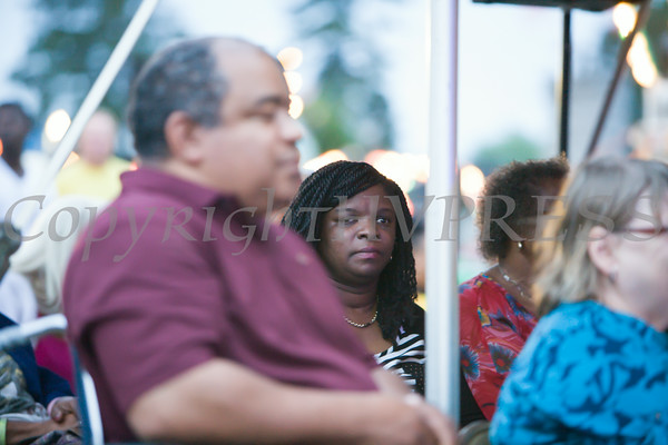 Felicia Cole, mother to The Voices of Glory, listens as they  performed at the 26th Annual International Festival held over the Labor Day Weekend in the City of Newburgh. Hudson Valley Press/CHUCK STEWART, JR.