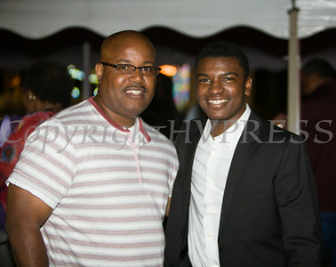 Newburgh Enlarged City School District Board of Education President Philip Howard with Avery Cole of the Voices of Glory, who performed at the 26th Annual International Festival held over the Labor Day Weekend in the City of Newburgh. Hudson Valley Press/CHUCK STEWART, JR.