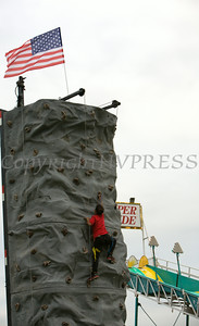 Children enjoy the rock climbing wall at the 26th Annual International Festival held over the Labor Day Weekend in the City of Newburgh. Hudson Valley Press/CHUCK STEWART, JR.