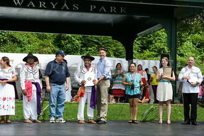 NYS Senator Terry Gispon presents Grupo Folclorico de Poughkeepsie with a certificate as NYS Assemblyman Frank Skartados looks on during the sixth annual La Guelaguetza was held in Waryas Park in Poughkeepsie, NY on Sunday, August 3, 2014. Hudson Valley Press/CHUCK STEWART, JR.
