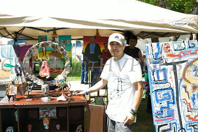 Salvador Moreno displays his art work at the sixth annual La Guelaguetza which was held in Waryas Park in Poughkeepsie, NY on Sunday, August 3, 2014. Hudson Valley Press/CHUCK STEWART, JR.
