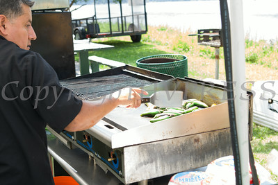 Alequndo Juarez of El Danzante in Kingston prepares food during the sixth annual La Guelaguetza which was held in Waryas Park in Poughkeepsie, NY on Sunday, August 3, 2014. Hudson Valley Press/CHUCK STEWART, JR.