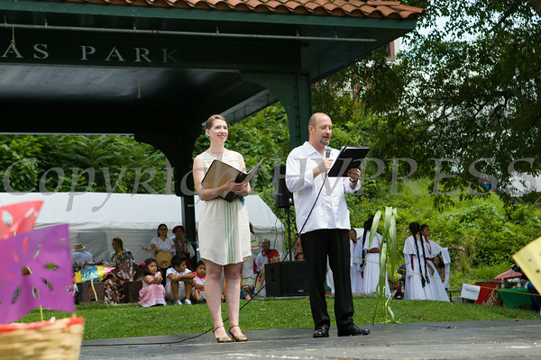 Elizabeth Celaya and Aldo Cano introduces the many performers during the sixth annual La Guelaguetza which was held in Waryas Park in Poughkeepsie, NY on Sunday, August 3, 2014. Hudson Valley Press/CHUCK STEWART, JR.