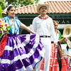 Dancers entertain hundreds of people gathered for the sixth annual La Guelaguetza held in Waryas Park in Poughkeepsie, NY on Sunday, August 3, 2014. Hudson Valley Press/CHUCK STEWART, JR.