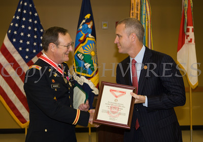 Rep. Sean Patrick Maloney presented Colonel James P. Monagle with the Legion of Merit Medal during a ceremony at the Armed Forces Reserve Center at Stewart Airport on Friday, October 17, 2014. Hudson Valley Press/CHUCK STEWART, JR.