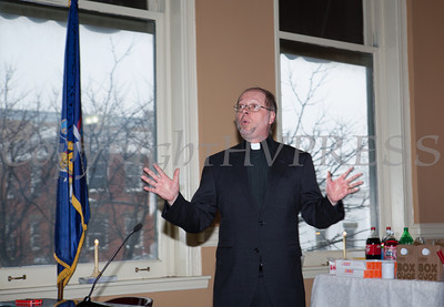 The Rev. Timothy J. Riss offers the invocation during the swearing-in of council members Regina Angelo, Genie Abrams, Cindy Holmes and Karen Mejia, at Newburgh's City Hall under the new ward system on Saturday, January 11, 2014. Hudson Valley Press/CHUCK STEWART, JR.