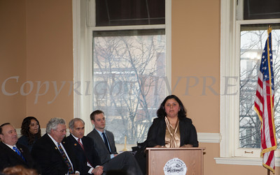 Council member Karen Mejia addresses those gathered for the swearing-in of new council members at Newburgh's City Hall on Saturday, January 11, 2014. Hudson Valley Press/CHUCK STEWART, JR.