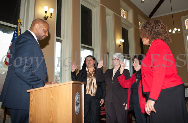 Judge Eddie Loren Williams administers the oath of office during the swearing-in of council members Karen Mejia, Genie Abrams, Regina Angelo and Cindy Holmes, at Newburgh's City Hall under the new ward system on Saturday, January 11, 2014. Hudson Valley Press/CHUCK STEWART, JR.
