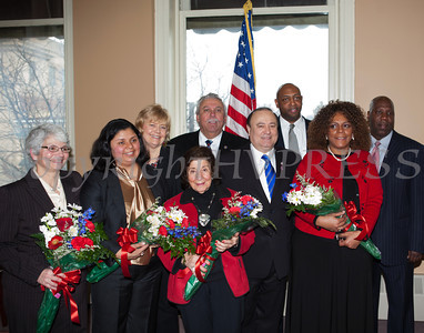 Councilwoman Genie Abrams, Councilwoman Karen Mejia, Mayor Judy Kennedy, Councilwoman Regina Angelo, Orange County Legislator James Kulisek, NY State Assemblyman Frank Skartados, Newburgh City Court Judge Eddie Loren Williams, Councilwoman Cindy Holmes and Councilman Cedrick Brown pose for a picture following the swearing-in of new council members at Newburgh's City Hall on Saturday, January 11, 2014. Hudson Valley Press/CHUCK STEWART, JR.