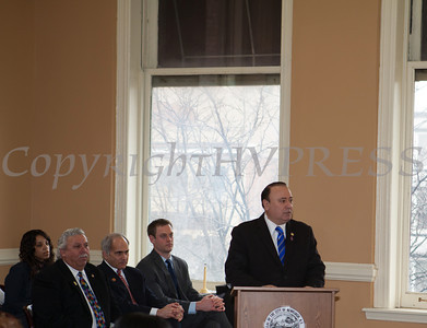 New York State Assemblyman Frank Skartados addresses those gathered for the swearing-in of new council members at Newburgh's City Hall on Saturday, January 11, 2014. Hudson Valley Press/CHUCK STEWART, JR.