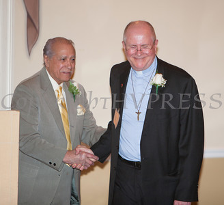 Orange County Human Rights Commission 2014 Award Honorees Amado Valdes and The Rev. Stephen Ruelke shake hands during the annual dinner, held on Thursday, April 10, 2014 at The Fountains in Middletown, NY. Hudson Valley Press/CHUCK STEWART, JR.