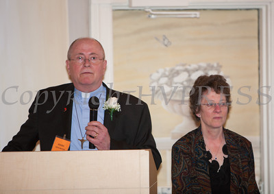 The Rev. Stephen Ruelke offers remarks after receiving the Orange County Human Rights Commission 2014 Award during a dinner on Thursday, April 10, 2014, as his wife Ruth looks on at The Fountains in Middletown, NY. Hudson Valley Press/CHUCK STEWART, JR.