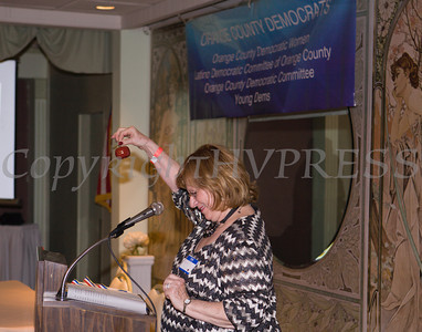 OCDW President Willa Freiband rings the bell to start the gala program at the Orange County Democratic Women 2014 Gala Dinner on Saturday, April 26, 2014 at the Meadowbrook Lodge in New Windsor, NY. Hudson Valley Press/CHUCK STEWART, JR.