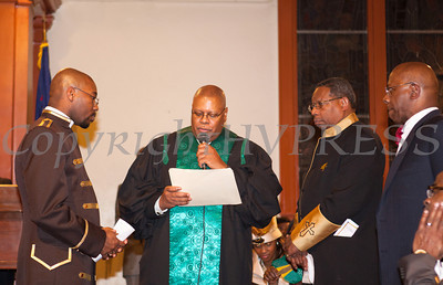 "Rev. Byron Williams offers the ""Charge to Pastor"" to Rev. Dr. Erik Maurice Pogue who was installed as the new pastor of New Hope Missionary Baptist Church on Sunday, March 30, 2014 in Newburgh, NY. Hudson Valley Press/CHUCK STEWART, JR."