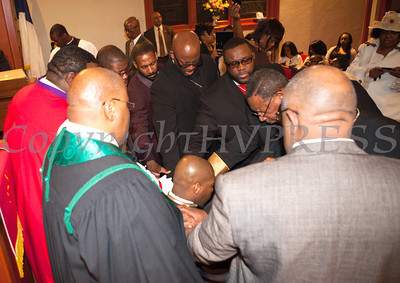 Laying on of Hands by Clergy for Rev. Dr. Erik Maurice Pogue who was installed as the new pastor of New Hope Missionary Baptist Church on Sunday, March 30, 2014 in Newburgh, NY. Hudson Valley Press/CHUCK STEWART, JR.