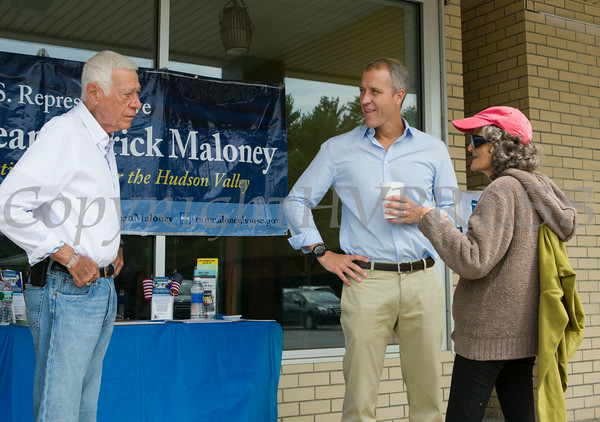"""US Rep Sean Patrick Maloney speaks with Fran Shapiro during his """"Speak with Sean"""" series, his local neighborhood office hours, in New Windsor, NY on Saturday, July 19, 2014 as Town Supervisor George Green listens. Hudson Valley Press/CHUCK STEWART, JR."""