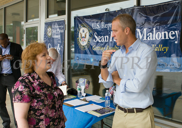 """US Rep Sean Patrick Maloney speaks with Lorraine McNeill during his """"Speak with Sean"""" series, his local neighborhood office hours, in New Windsor, NY on Saturday, July 19, 2014. Hudson Valley Press/CHUCK STEWART, JR."""