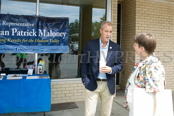 """US Rep Sean Patrick Maloney speaks with Sharon Waddell during his """"Speak with Sean"""" series, his local neighborhood office hours, in New Windsor, NY on Saturday, July 19, 2014. Hudson Valley Press/CHUCK STEWART, JR."""