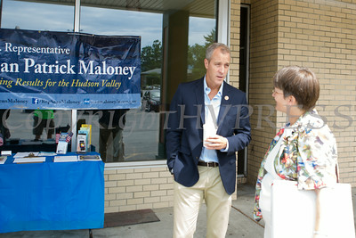 "US Rep Sean Patrick Maloney speaks with Sharon Waddell during his ""Speak with Sean"" series, his local neighborhood office hours, in New Windsor, NY on Saturday, July 19, 2014. Hudson Valley Press/CHUCK STEWART, JR."