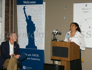 A woman talks about the pathways to citizenship as US Rep Sean Patrick Maloney listens at the U.S. Citizenship and Immigration Services Customer Service Center open house at the Newburgh Armory Unity Center on Saturday, July 12, 2014 in Newburgh, NY. Hudson Valley Press/CHUCK STEWART, JR.