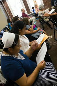 Attendees sing a song during the U.S. Citizenship and Immigration Services Customer Service Center open house at the Newburgh Armory Unity Center on Saturday, July 12, 2014 in Newburgh, NY. Hudson Valley Press/CHUCK STEWART, JR.