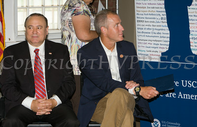 Assemblyman Frank Skartados and US Rep Sean Patrick Maloney listen to speakers at the U.S. Citizenship and Immigration Services Customer Service Center open house at the Newburgh Armory Unity Center on Saturday, July 12, 2014 in Newburgh, NY. Hudson Valley Press/CHUCK STEWART, JR.