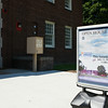 A sign outside the Newburgh Armory Unity Center in Newburgh, NY on Saturday, July 12, 2014 invites people to the U.S. Citizenship and Immigration Services Customer Service Center open house. Hudson Valley Press/CHUCK STEWART, JR.