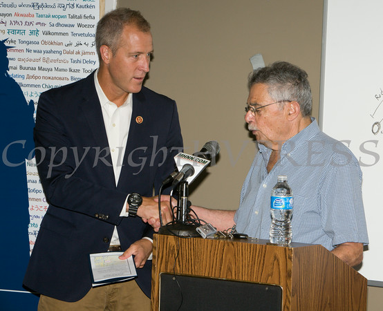 US Rep Sean Patrick Maloney and William Kaplan address those gathered at the U.S. Citizenship and Immigration Services Customer Service Center open house at the Newburgh Armory Unity Center on Saturday, July 12, 2014 in Newburgh, NY. Hudson Valley Press/CHUCK STEWART, JR.