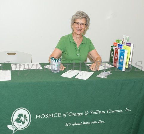 """Helen Richards of Hospice of Orange & Sullivan Counties hands out literature at US Rep Sean Patrick Maloney's """"When Women Succeed, America Succeeds"""" Forum and Resource Fair Saturday, July 26 at the Orange County Emergency Services Center in Goshen, NY. Hudson Valley Press/CHUCK STEWART, JR."""