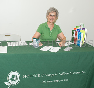 "Helen Richards of Hospice of Orange & Sullivan Counties hands out literature at US Rep Sean Patrick Maloney's ""When Women Succeed, America Succeeds"" Forum and Resource Fair Saturday, July 26 at the Orange County Emergency Services Center in Goshen, NY. Hudson Valley Press/CHUCK STEWART, JR."