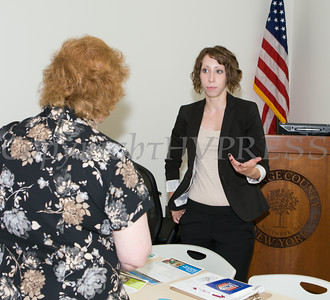 "April Tetreault of Glenmont Job Corps hands out literature at US Rep Sean Patrick Maloney's ""When Women Succeed, America Succeeds"" Forum and Resource Fair Saturday, July 26 at the Orange County Emergency Services Center in Goshen, NY. Hudson Valley Press/CHUCK STEWART, JR."