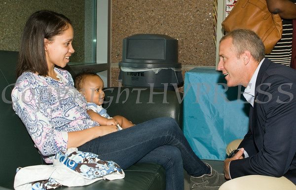 """US Rep Sean Patrick Maloney speaks with Selina Ronero and her seven-month old baby Noah after he hosted """"When Women Succeed, America Succeeds"""" Forum and Resource Fair Saturday, July 26 at the Orange County Emergency Services Center in Goshen, NY. Hudson Valley Press/CHUCK STEWART, JR."""