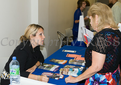 "Kyle Steller of Legal Services of the Hudson Valley hands out literature at US Rep Sean Patrick Maloney's ""When Women Succeed, America Succeeds"" Forum and Resource Fair Saturday, July 26 at the Orange County Emergency Services Center in Goshen, NY. Hudson Valley Press/CHUCK STEWART, JR."