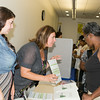 "Faith Moore and daughter Serra of OC Rural Development Advisory Corp. hand out literature at US Rep Sean Patrick Maloney's ""When Women Succeed, America Succeeds"" Forum and Resource Fair Saturday, July 26 at the Orange County Emergency Services Center in Goshen, NY. Hudson Valley Press/CHUCK STEWART, JR."