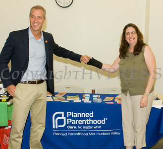 "US Rep Sean Patrick Maloney speaks with Planned Parenthood Mid-Hudson Valley's Annette Marzan after he hosted ""When Women Succeed, America Succeeds"" Forum and Resource Fair Saturday, July 26 at the Orange County Emergency Services Center in Goshen, NY. Hudson Valley Press/CHUCK STEWART, JR."