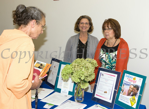 """Caren Fairweather and Lynda Brady of Maternal Infant Services Network hand out literature at US Rep Sean Patrick Maloney's """"When Women Succeed, America Succeeds"""" Forum and Resource Fair Saturday, July 26 at the Orange County Emergency Services Center in Goshen, NY. Hudson Valley Press/CHUCK STEWART, JR."""