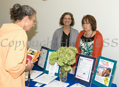 "Caren Fairweather and Lynda Brady of Maternal Infant Services Network hand out literature at US Rep Sean Patrick Maloney's ""When Women Succeed, America Succeeds"" Forum and Resource Fair Saturday, July 26 at the Orange County Emergency Services Center in Goshen, NY. Hudson Valley Press/CHUCK STEWART, JR."