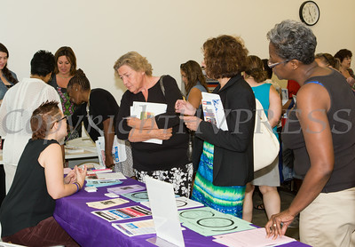 "Jen Herman of Safe Homes of Orange County hands out literature at US Rep Sean Patrick Maloney's ""When Women Succeed, America Succeeds"" Forum and Resource Fair Saturday, July 26 at the Orange County Emergency Services Center in Goshen, NY. Hudson Valley Press/CHUCK STEWART, JR."